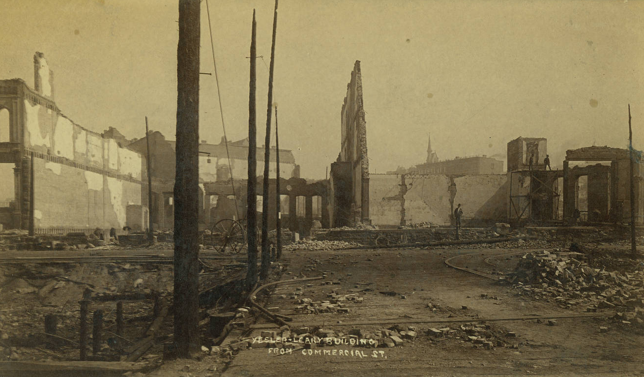 looking north on 1st Ave. S. at Yesler toward the ruins of the Yesler-Leary Building.png